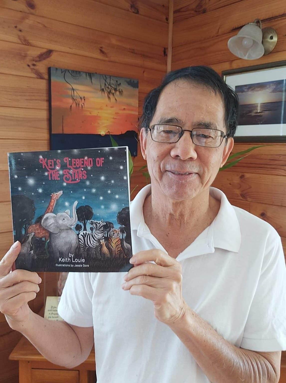 Photo-Keith-holding-Stars-book-1146x1536